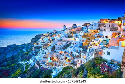 Church of Santorini. Fira town on Santorini island, Greece. Incredibly romantic sunset on Santorini. Oia village in the morning light. Amazing sunset view with white houses. Island of lovers. Postcard