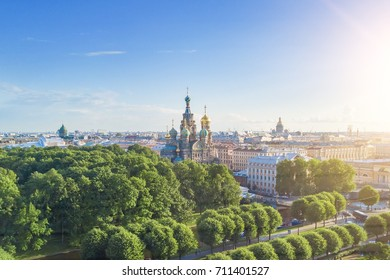 Church of the Savior on Spilled Blood behind the green trees in the sunshine, Saint Petersburg, Russia
