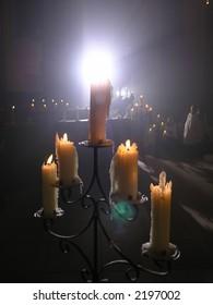Church service behind a shining Candelabra