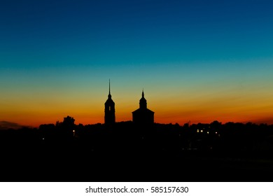 Church silhouette with a bell tower on sunset sky background