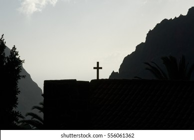 church silhouette in mountains