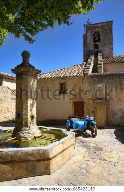 The  Church and a Small Square with a Fountain in Le Barroux, Provence, France