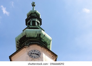 Church spire with clock.The spire of the Bratislava Cathedral against the blue sky.