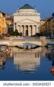 Church of St. Anthony Healer (commonly called the Church of Sant Antonio Nuovo), main religious building of the Borgo Teresiano and the center of Trieste. Canal river with reflections.