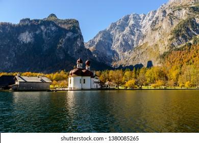Church St. Bartholomew  (Bartholoma, Bartholomae) on Konigssee (Königssee, Königsee, Konigssee, Koenigssee, Koenigsee,) lake in autumn. Bayern (Bavaria), Germany.