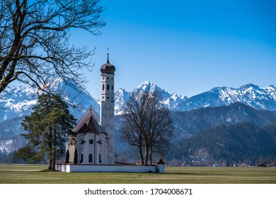 Church St. Coloman nearby Schwangau in springtime with snowcovered Tannheimer mountains in the background