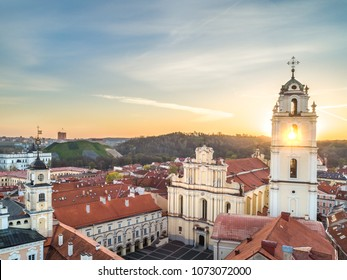 The church of St. Johns and Vilnius old town panorama in morning taken from drone