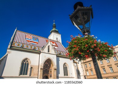 Church of St. Mark and flowers jardiniere, Zagreb, Croatia, Europe. Upper town, Gornji Grad, historical part of old Zagreb