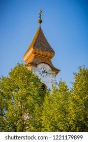 Church of St. Philip and James in Vukovar, Croatia peaks through