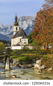 The Church of St. Sebastian in Ramsau bei Berchtesgaden in Bavaria, Germany. With the mountain stream Ramsauer Ache.