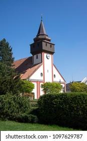 Church of St. Wenceslas in town Svetla nad Sazavou, clock tower, sunlight, greenery and blue sky - Shutterstock ID 1097629787