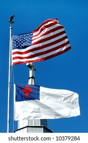 Church stands between the Christian flag and the American Flag.
