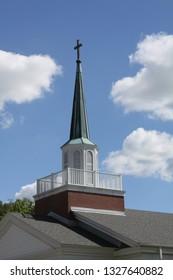 Church steaple against a blue sky.