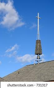 Church steeple against blue sky