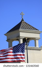 Church steeple with an American Flag