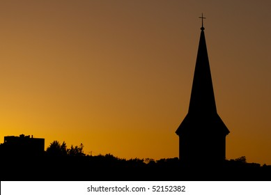 Church steeple silhouette at sunset