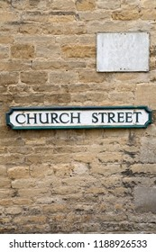 Church Street Road Sign on Stone Wall