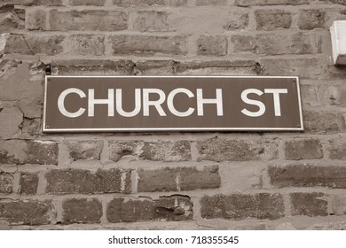 Church Street Sign on Brick Wall Facade in Black and White Sepia Tone