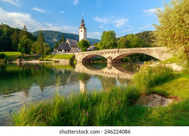 Church of Sv. John the Baptist and a bridge by the Bohinj lake, Slovenia