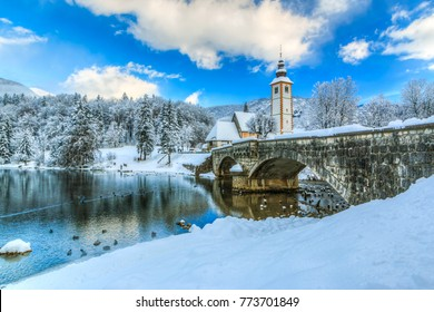 Church of Sv. John the Baptist and a bridge by the Bohinj lake  in winter, Slovenia