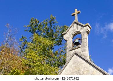 Church tower details in Auvers-sur-Oise village, France