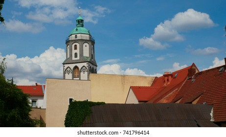 Church tower on a bluish background in Meissen city in Saxony, Germany. The characteristic bells of the church are made of porcelain.