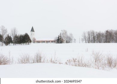 Church tower school in snowy winter