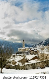 The church tower in the village of Soglion in Switzerland in winter.