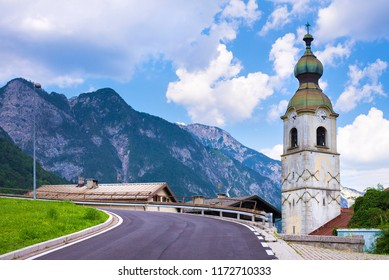 Church in town of Pontebba, Italy. View from the Bicycle road Alpe Adria in Italian Alps.