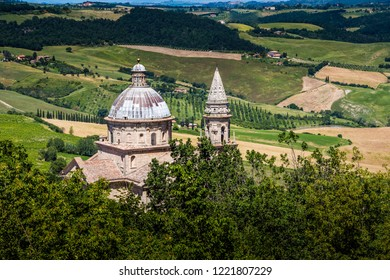 Church from a Tuscany town overlooking a beautiful farm