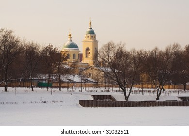"Church of the ""Vseh Skorbyashchih radost'"" Holy Mother icon in Kalitniki cemetary in Moscow, view over the frozen pond - Shutterstock ID 31032511"