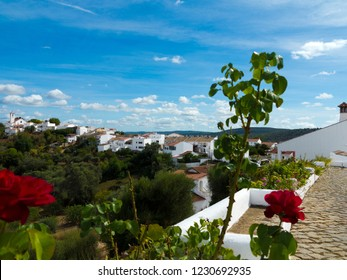 Church and white houses of the beautiful ancient village Salir, Algarve, Portugal with a view to the mountain landscape