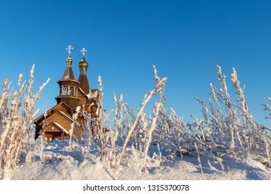 Church in winter with bushes and snow. November 1, 2018. Norilsk