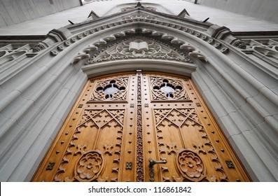 Church wooden door decorated with bas-relief. St. Gallen, Switzerland.