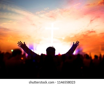 Church worship concept:Silhouette of Christian prayers raising hand while praying to the Jesus