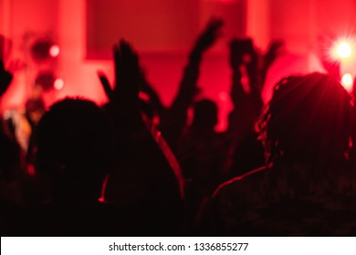 Church Worship Concert with Hands Lifted Smart Phones Lights