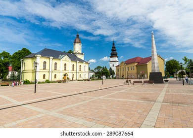 Churches in the centre of the village Partizanska Lupca, Slovakia on June 3, 2015 - Shutterstock ID 289087664
