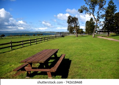 Churchill Island Heritage farm, a table on a green field overlooking blue sky