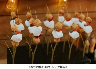 churro bar at wedding reception, churros at event, close up, dipped