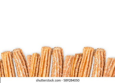 Churros arranged in row and isolated on white background