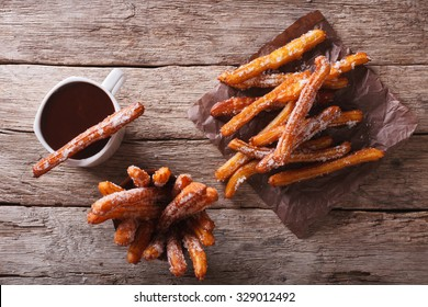 churros and hot chocolate  on the table. horizontal view from above