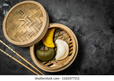 Chuseon day concept, korean thanksgiving day - songpyeon rice cakes on rustic background, top view