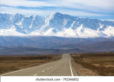 Chuya highway and snowy peaks Chuya ridge at Altai mountains, Russia.