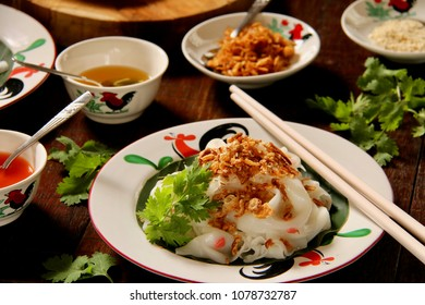 Ci Cong Fan. Chinese Street Food of Rice Noodle Sheets with Fried Shallots, Sesame Seeds, Sesame Oil and Soy Sauce.