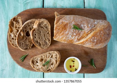 ciabatta bread and olive oil on wooden surface