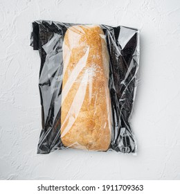 Ciabatta panini bread in a plastic bag, on white background, top view flat lay