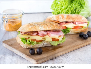 Ciabatta sandwich with bacon and cheese on wooden boarde,selective focus