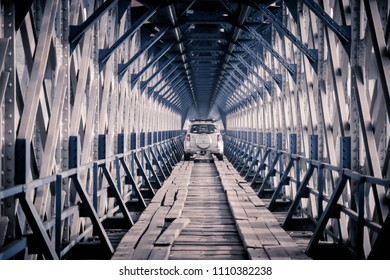 Ciamis, West Java / Indonesia -  March 13, 2016 : A MPV Across Cirahong Bridge, A Double Deck Structure of Metal Railway Bridge and Car Bridge Underneath Made by Dutch Colonial, Asia