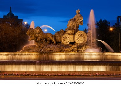 Cibeles Fountain at night in city of Madrid, Spain. Fountain from 1782 on Plaza de Cibeles depicts Cybele, the Great Mother and Roman goddess of fertility and agriculture on chariot drawn by lions