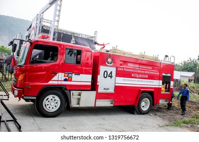 Cibinong, Indonesia - September 09th 2015:  A Firetruck Parking on the Side of A Road